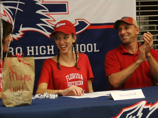 Estero High School cross country runner Alayna Goll signs with Florida Southern College on Nov. 88, 2017.
