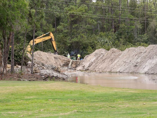 Construction crews work on drainage problems on the