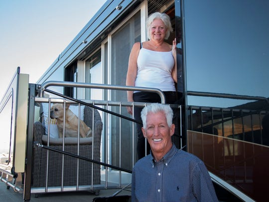 Reyne and Leo Hillyer stand outside of their RV with