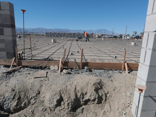 Construction of a marijuana grow house on land belonging to Ajax Auto Parts in Coachella on Thursday, November 9, 2017. Auto salvage businesses in an area of Coachella are turning to marijuana growing.
