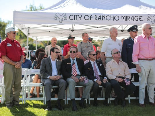 Veterans stand to be recognized, as music for their branch of the military is played, at the Rancho Mirage's Veterans Day celebration on Saturday, November 11, 2017 at Rancho Mirage Community Park.