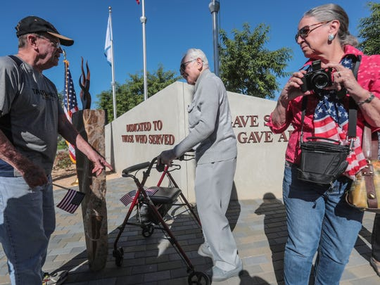 WWII air force veteran Boris Elkin, 99, center, walks in front of the newly unveiled Veteran Recognition Wall and Memorial Flame monument to have his photo taken during Rancho Mirage's Veterans Day celebration on Saturday, November 11, 2017 at Rancho Mirage Community Park.