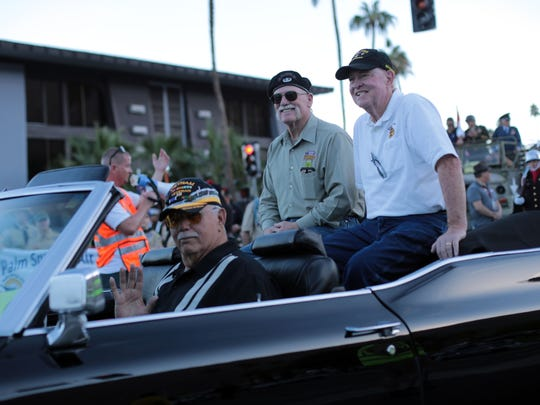 Silver Star medal recipient Don Simpson, right, and veteran advocate Roony Imel ride in back of a convertible during the Palm  Springs Veterans Day Parade on Saturday, November 11, 2017 in Palm Springs.