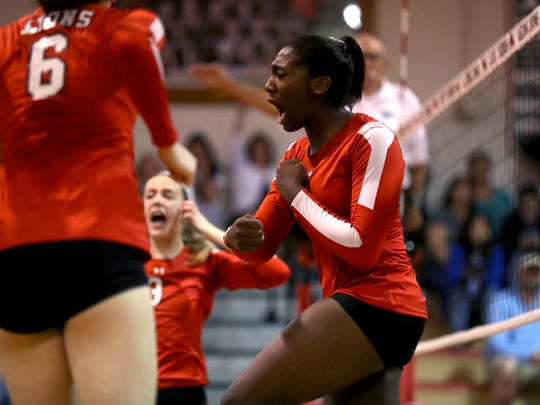 Leon's Makayla Washington celebrates a point against Hagerty in their State Semi-Final FHSAA Girls Volleyball matchup at Leon High School on  Saturday, Nov. 11, 2017.