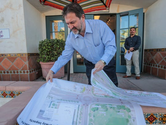 Interim city engineer Bryan McKinney unfolds La Quinta's plans to make the Village more pedestrian and bicycle friendly on Tuesday, November 2, 2017, in La Quinta.