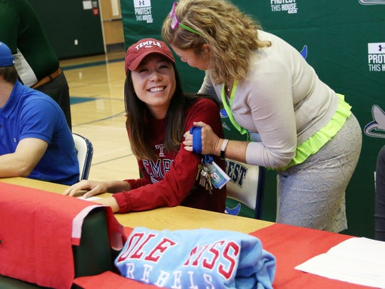 Seacrest volleyball player Gem Grimshaw smiles after signing with Temple University during Seacrest Country Day's signing ceremony on Wednesday, Nov. 15, 2017.