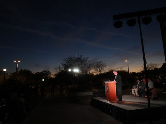 FSU President John Thrasher speaks during a vigil in