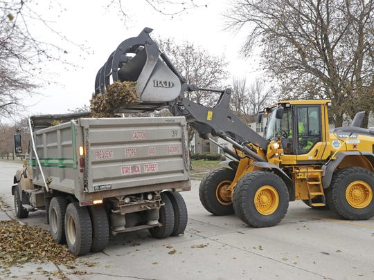 Leaves collected in Green Bay are hauled to the city's
