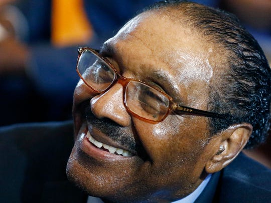 In this Aug. 9, 2017 file photograph, former Democratic speaker pro tempore Robert Clark smiles as he in congratulated by well wishers for overcoming barriers 50 years ago to become Mississippi's first black legislator since Reconstruction at the Old Capitol Museum in Jackson, Miss. State Sen. John Horhn, D-Jackson, says art at the Mississippi Capitol should be updated to reflect accomplishments of African-Americans, and he would like to see statues of Clark and the late State Sen. Henry J. Kirksey, D-Jackson.