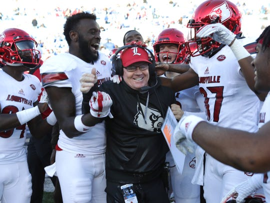 Louisville coach Bobby Petrino celebrated with his