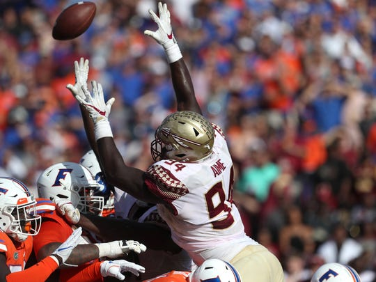 FSU's Walvenski Aime attempts to block a field goal against Florida during the Seminoles 38-22 win at Ben Hill Griffin Stadium in Gainesville on Saturday.