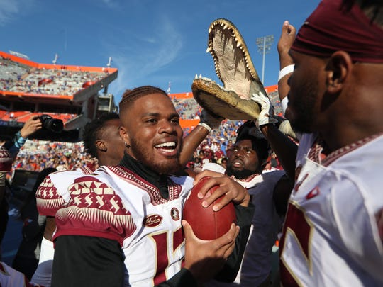 FSU celebrates after the Seminoles 38-22 win over Florida