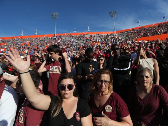 Fans watch as the Seminoles take on the Florida Gators at Ben Hill Griffin Stadium in Gainesville on Saturday.