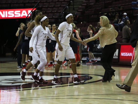 FSU women's basketball coach Sue Semrau congratulating the Seminoles in FSU's 87-62 victory against Samford on Sunday afternoon at the Tucker Center.