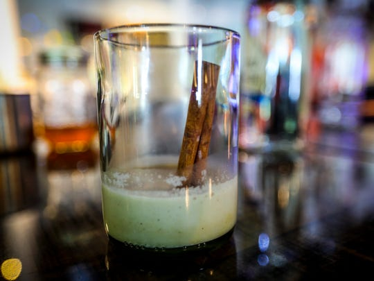 Add a cinnamon stick for flavor and a fun stir stick. Coquito, Puerto Rico's take on eggnog. Wanda Lopez, who runs the SWFL Foodies Facebook group, was at Big Blue Brewing in Cape Coral showing how she makes her coquito.