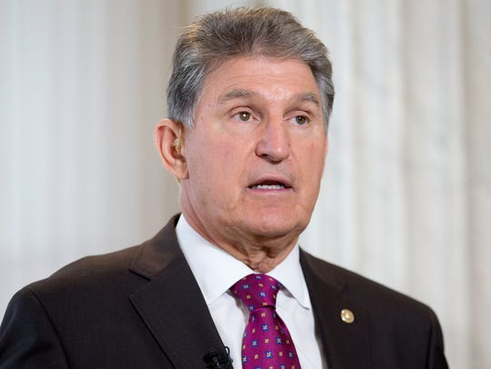 Sen. Joe Manchin, D-W.Va., participates in an interview for television on Capitol Hill in Washington on Oct. 17, 2017.