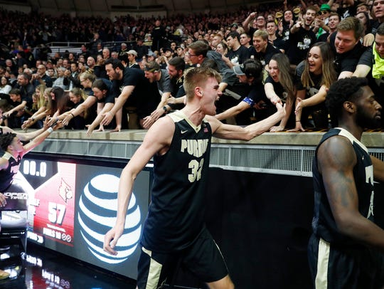 Purdue Boilermakers forward Matt Haarms (32) high fives