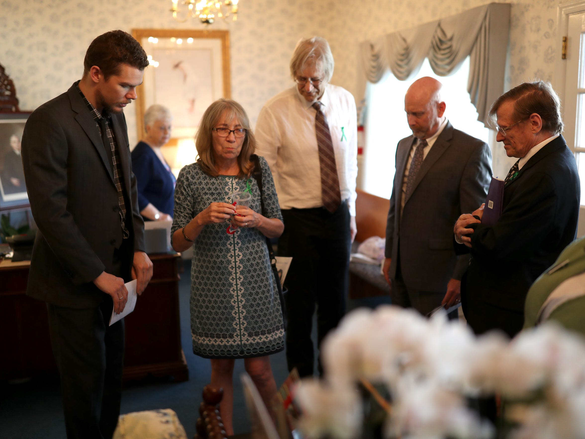 Beth Frederick and Steven Hjelm, center, enter the funeral for their daughter Jennifer Casey Norred on Sunday, July 30, 2017. Correctional staff at the Leon County jail found Norred's body in her cell after she killed herself.