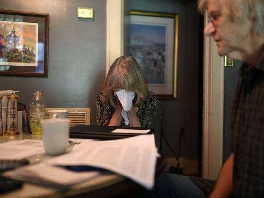 Steve Hjelm and Beth Frederick, who wipes tears from her face, speak from their home about their daughter Jennifer Casey Norred, who was found in her cell by correctional staff at the Leon County Jail after she died of suicide.