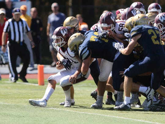 The Old tappan defense stops Dario Sirni of Wayne Hills