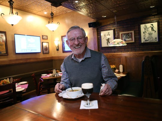 Owner Frank Burke enjoys a bowl of clam chowder and