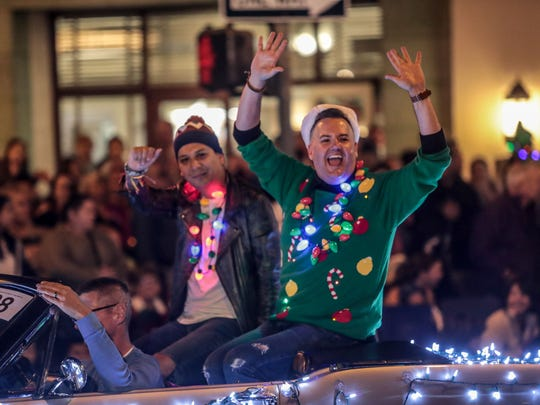 Celebrity Ross Mathews, right, rides in the Palm Springs Festival of Lights Parade on Saturday, December 2, 2017.