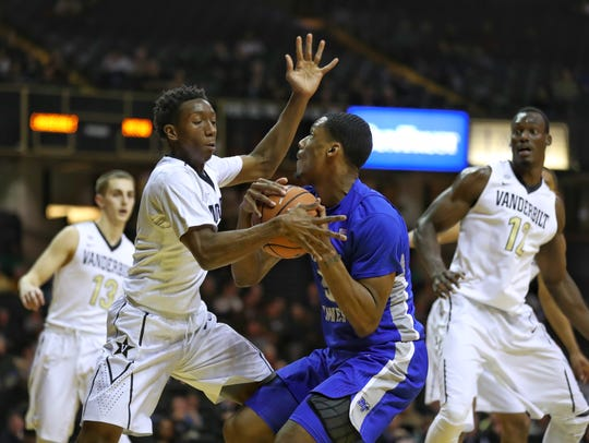 MTSU forward Nick King drives against Vanderbilt guard