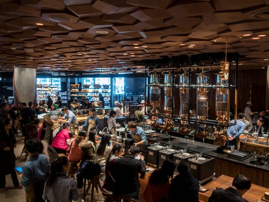 Visitors wait for their coffee at the Starbucks Reserve Roastery outlet in Shanghai.