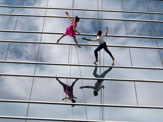 Dancers from the vertical dance troupe Bandaloop duet