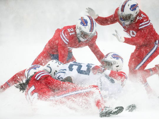 Marlon Mack of the Indianapolis Colts is tackled by the Buffalo Bills defense during the first quarter on Dec. 10, 2017 at New Era Field in Orchard Park.
