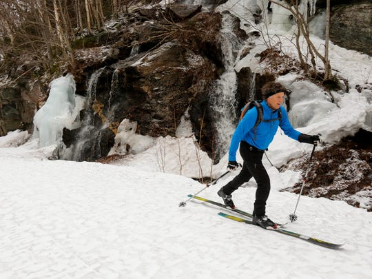 Pete Davis commutes from his home in Jericho to his job at Stowe Mountain Resort by skiing up and over Smugglers Notch.