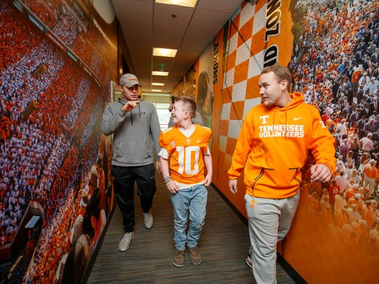 Keaton Jones with members of the Tennessee Volunteers football team during a visit to Anderson Training Center.