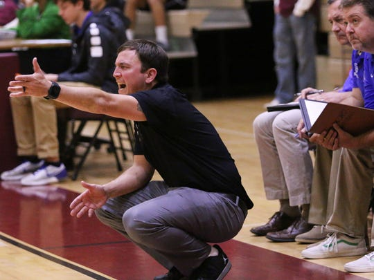 Canterbury boys basketball coach Darrin Wallace yells to his team during the Cougars' game against First Baptist in Naples on Tuesday, Dec. 12, 2017.