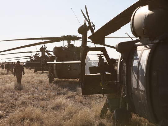Black Hawk helicopter crews from 3rd Battalion, 501st Aviation Regiment line up during the recent gunnery exercise.