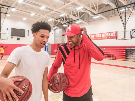 Pooh Richardson the assistant basketball coach at College of the Desert share a laugh with one of his players Dejon Talbert, 22, on November 30, 2017 in Palm Desert.