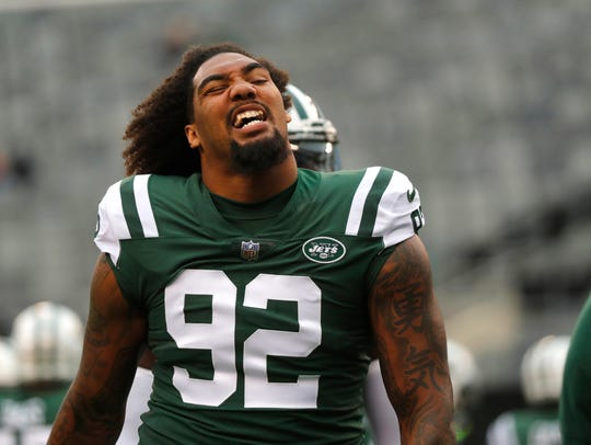 New York Jets' Leonard Williams warms-up before an