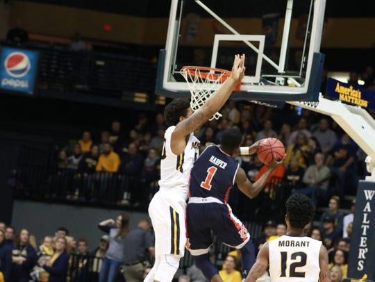 Auburn guard Jared Harper drives to the basket during