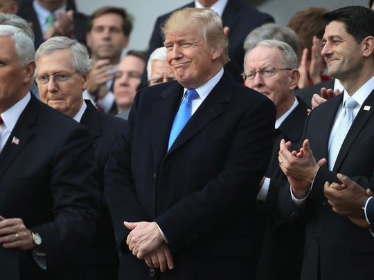 WASHINGTON, DC - DECEMBER 20:  U.S. President Donald Trump, flanked by Republican lawmakers, celebrates Congress passing the Tax Cuts and Jobs Act with Republican members of the House and Senate on the South Lawn of the White House on December 20, 2017 in Washington, DC. The tax bill is the first major legislative victory for the GOP-controlled Congress and Trump since he took office almost one year ago.  (Photo by Chip Somodevilla/Getty Images)