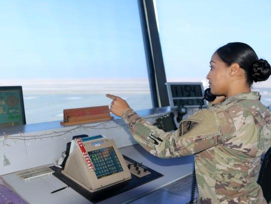 Staff Sgt. America V. Prado controls air traffic in