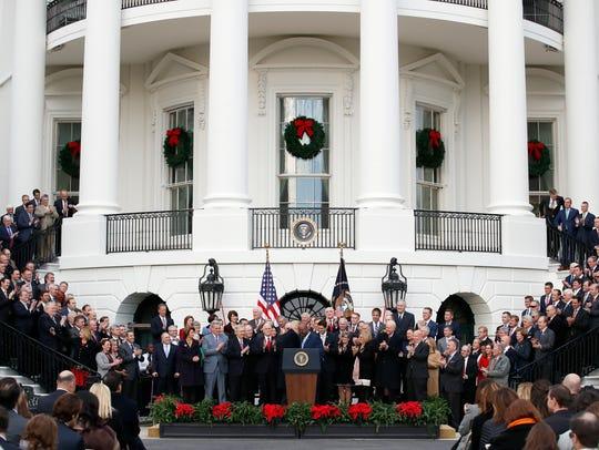 President Donald Trump greets Sen. Tim Scott, R-S.C.,