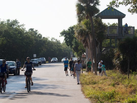 "Visitors to J.N. ""Ding"" Darling Wildlife Refuge enjoy"