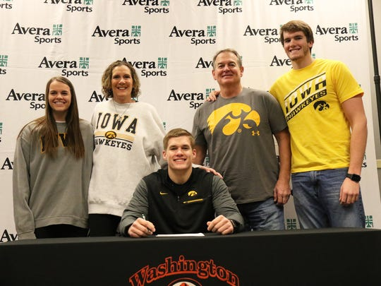 Seth Benson of Washington High poses with his parents, JoElle and Chuck, brother, Cole, and sister, Ellie, on Friday at the Avera Sports Institute after signing his national letter to play for Iowa.