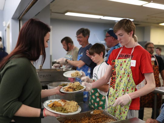 Trinity United Methodist Church holds their 30th anniversary Christmas dinner downtown, where volunteers worked to feed hundreds of homeless guests on Monday, Dec. 25. 2017.