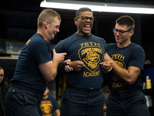 Police cadet Michael Love is shot with a Taser during training at the Corpus Christi Police Academy on Wednesday, Dec. 27, 2017.