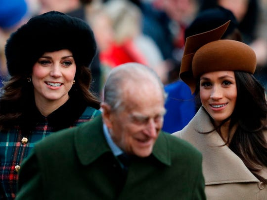 Prince Philip walks in front of Catherine, Duchess