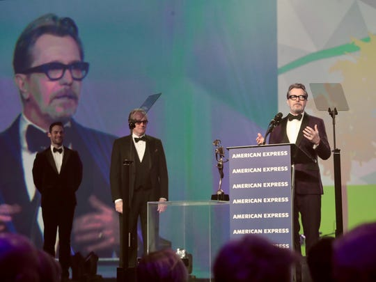 Gary Oldman announces Tuesday he and his wife will make Palm Springs their permanent home at the PSIFF. Behind him is presenter Peter Fonda.