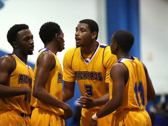 Rickards' Alic Troutman, center, talks to his team