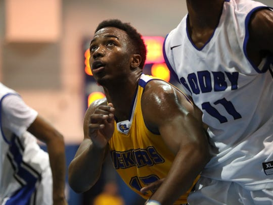 Rickards' Gentry Sparks battles for position on a rebound