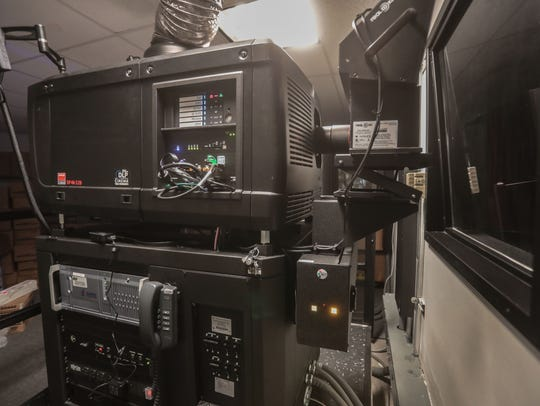 A digital projector inside a projection room at the