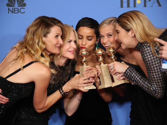 Laura Dern, from left, Nicole Kidman, Zoe Kravitz, Reese Witherspoon and Shailene Woodley lean in after the show wins the Golden Globe for best limited series.